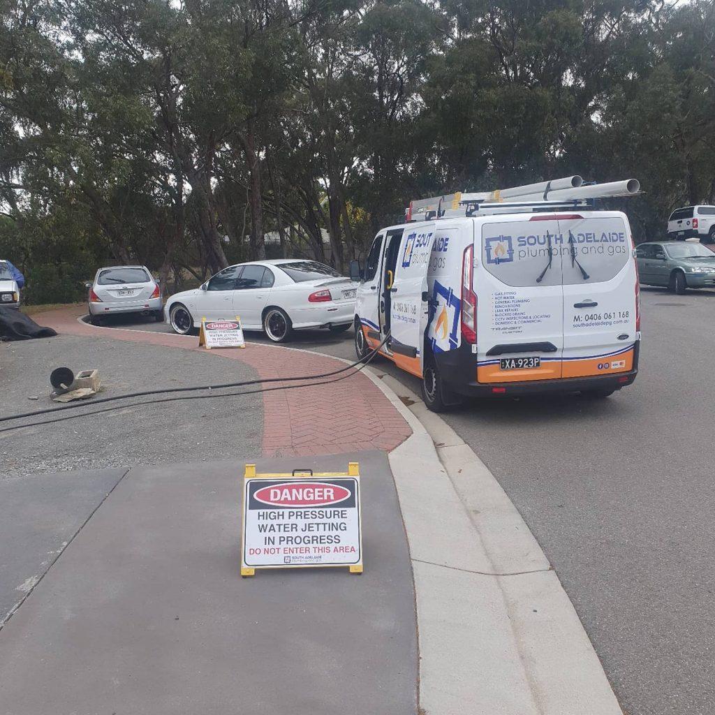 Plumbers van set up to clear a Reynella blocked drain