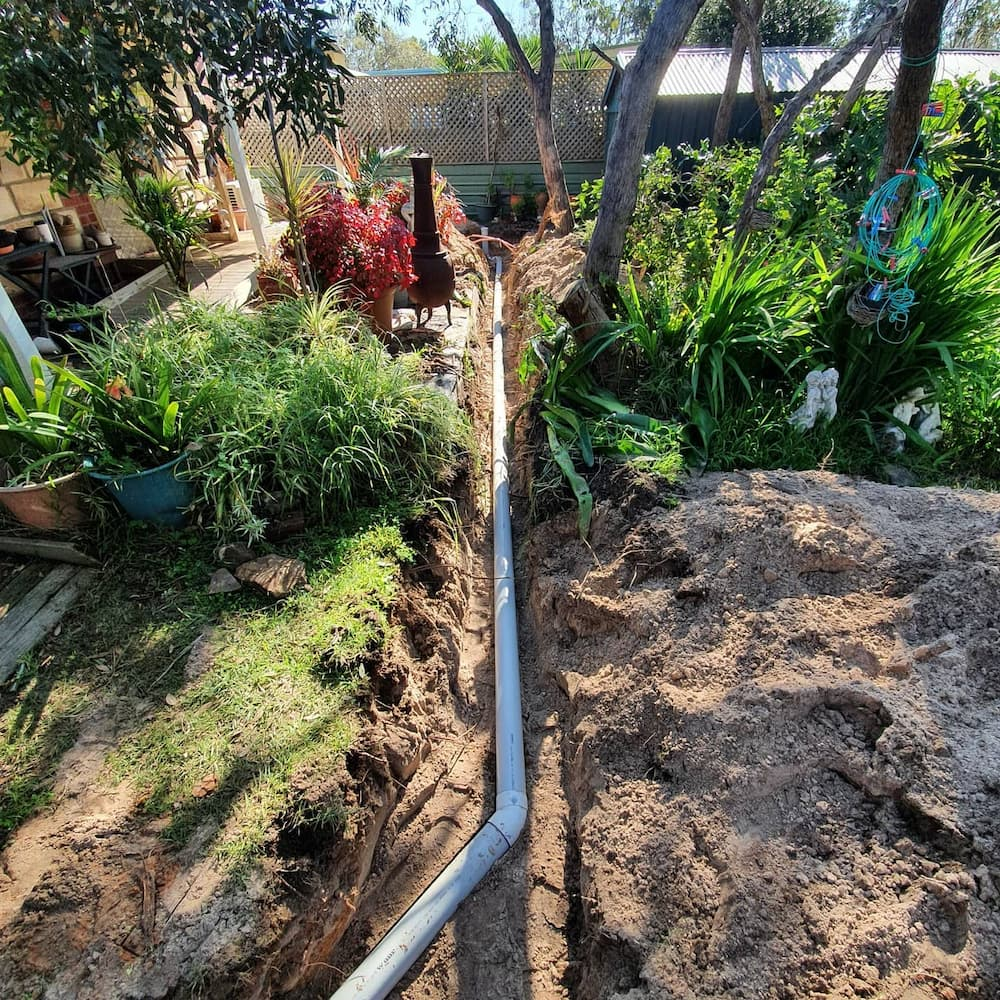 Reynella plumber digs a stormwater trench